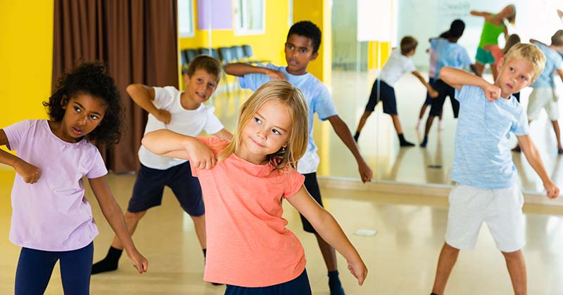Children doing gymnastics and dancing